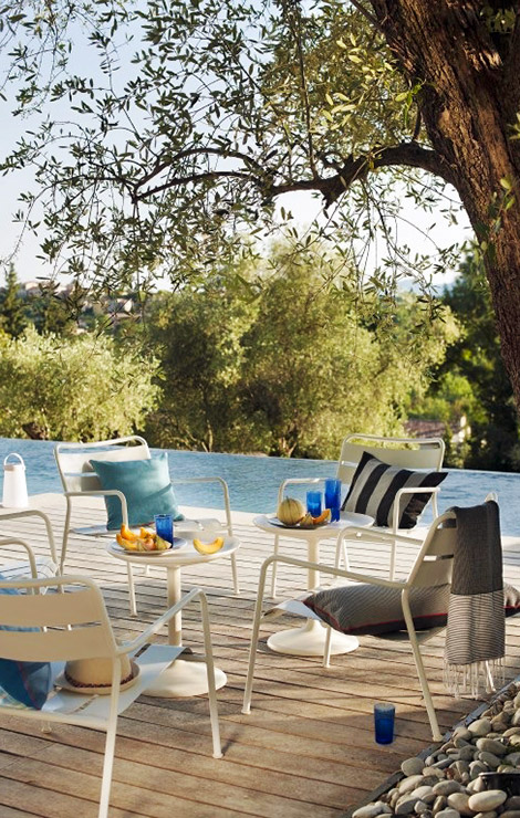 lounge area by infinity pool at luxury villa in valbonne